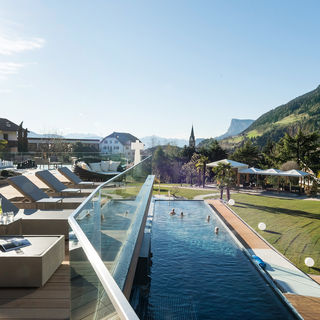 Outdoor pool with garden. Dolce Vita Hotel near Merano